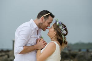 The groom playfully licks his bride's nose