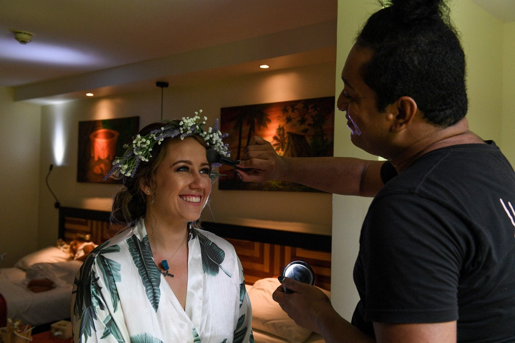 The bride gets her makeup done by Lodo of Totoka makeup