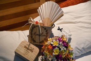 A customized wooden fan embroidered in the bride's name