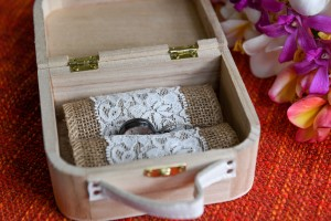 The silver rings are delicately nested in a lace mat