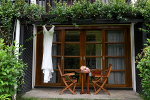 The bride's exquisite wedding gown is hung outside