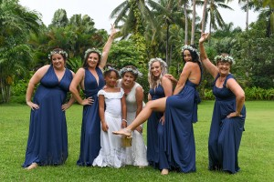 The bridal party pose for a saucy and fun picture before the wedding