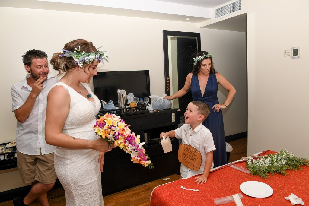 The bride has a good laugh with her son when finally ready to walk down the aisle