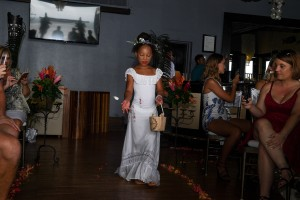 A beautiful Fiji flower girl scatters flowers down the aisle
