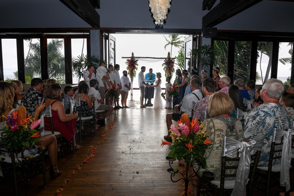 Wedding guests watch the wedding ceremony at Warwick Fiji