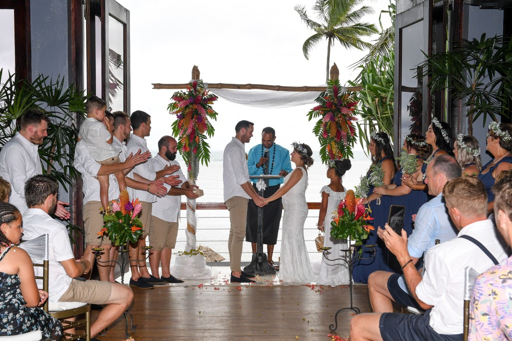 The newly weds exchange their vows at the tropical Fiji flower altar