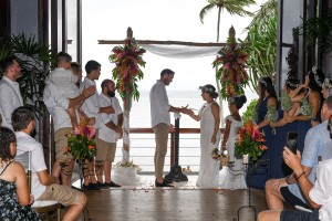 The groom slips a ring onto his bride's finger