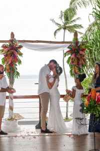 The newly weds share a passionate kiss at their beach altar at Warwick Fiji