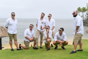 The groomsmen pose in front of the Pacific Ocean Fiji