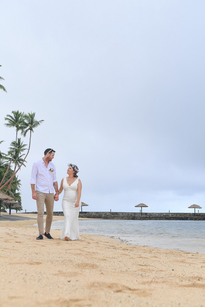 The newly weds stroll on the sandy beaches of Warwick Fiji