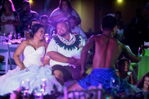 The newly weds reflect in their love as they watch traditional Fiji dancers entertain them