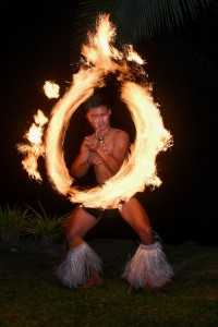 A traditional Fiji firedancer shows off at the wedding reception