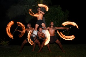 Traditional Fiji fire dancers light up the night sky at the wedding reception