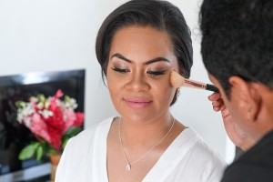 The stunning bride has her makeup done by Totoka Hair and makeup