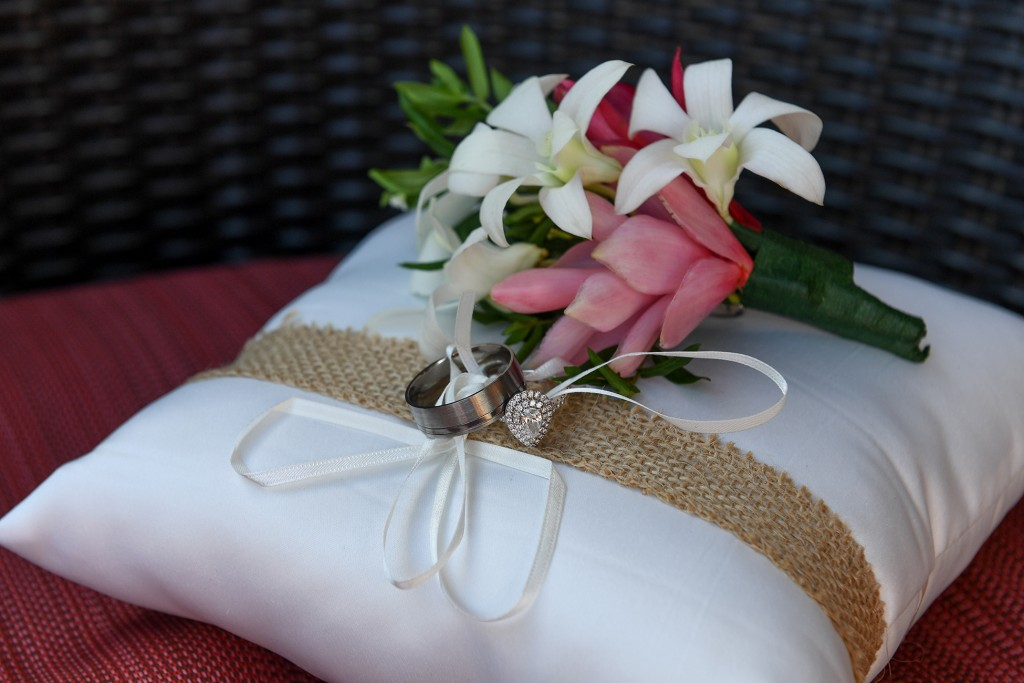Silver Michael Hill rings on a simple white cushion