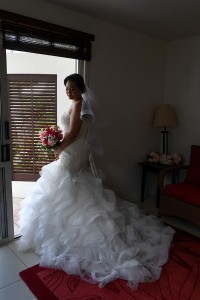 The stunning bride poses with her mermaid wedding gown