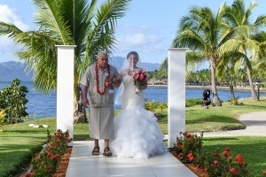 The father walks the bride down the aisle at the Sheraton Fiji