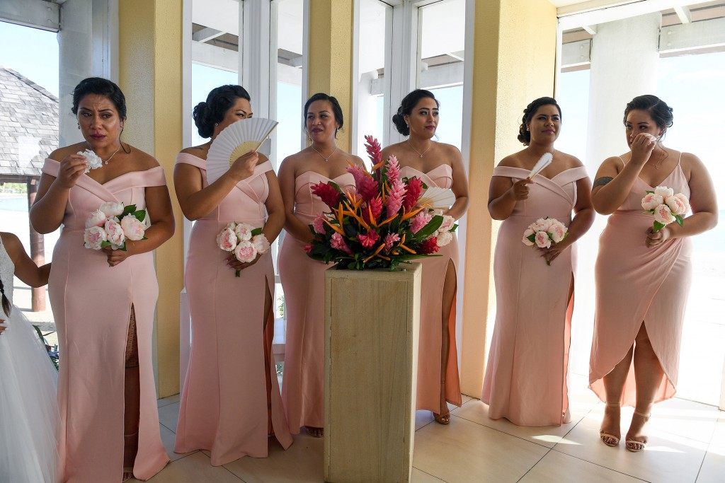 The bridesmaids tear up as the vows are recited