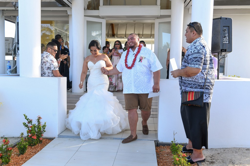 The newly weds celebrate as they file out of the Sheraton Fiji chapel