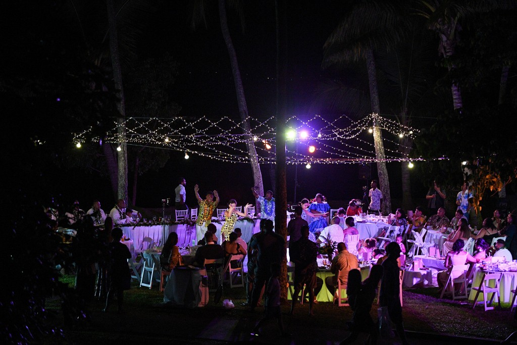 The wedding guests dance under fairy lights in the Fiji night sky