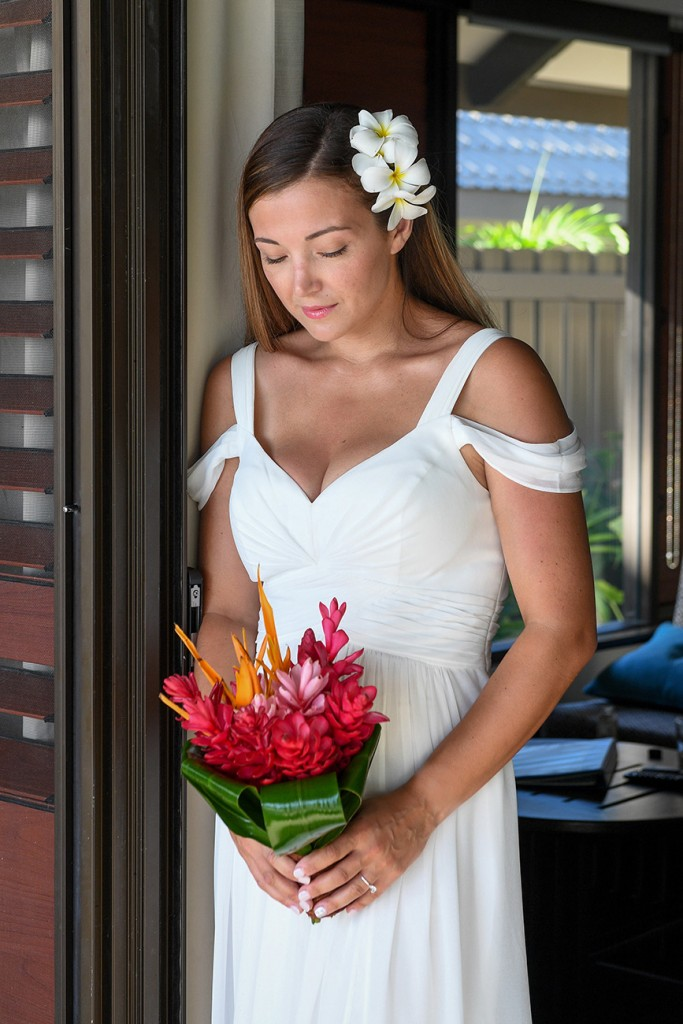 The bride holds a tropical ginger flower bouquet
