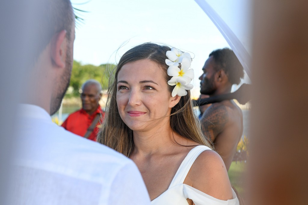 A closeup of the stunning bride at the aisle staring at her groom