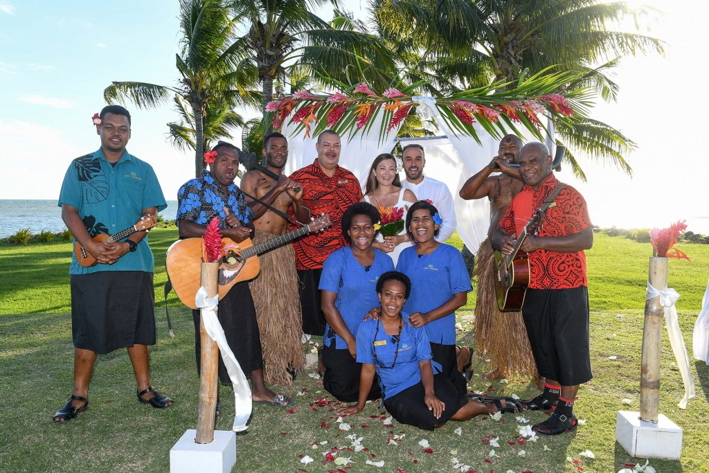 The traditional Fiji bridal team at Fiji landing pose for a picture