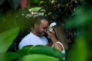 An intimate moment of the married couple in the forest is captured