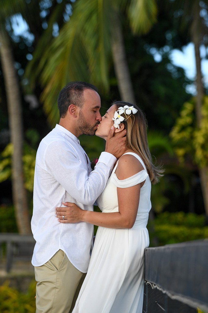 A portrait of the couple's passionate kiss against Fiji palm trees