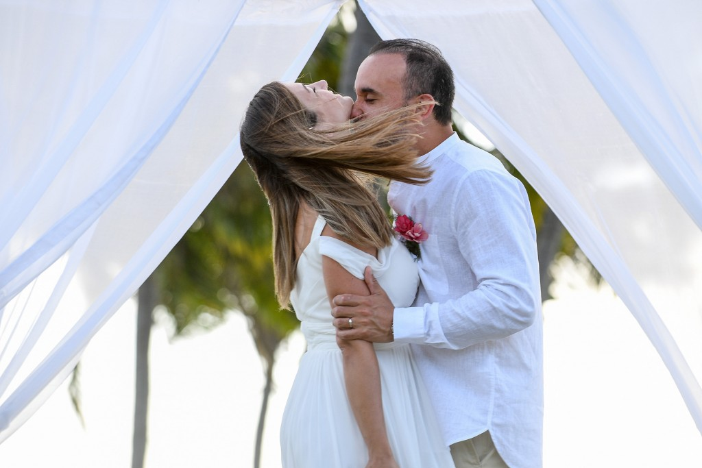 The groom passionately kisses his groom on the neck