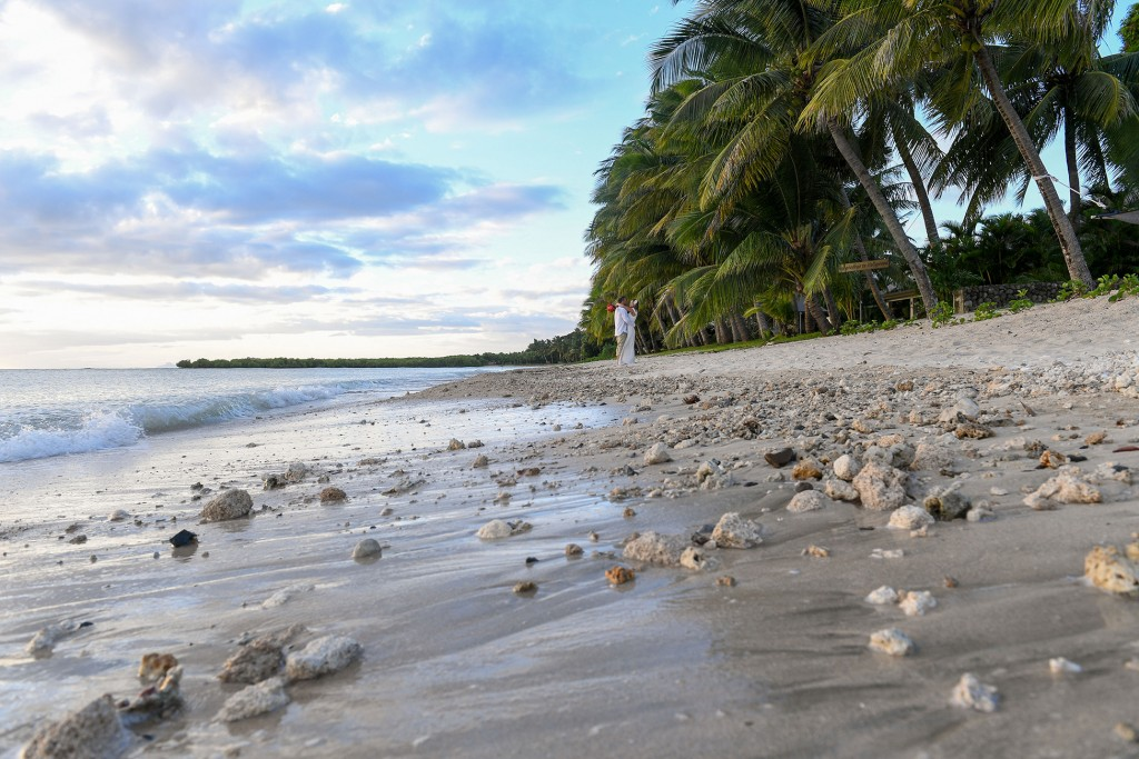 The couple embraces in the background of the rocky beach of Vuda Marina Fiji