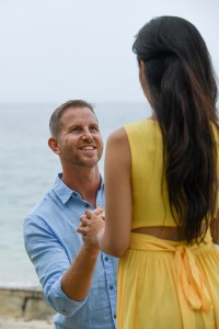 The earnest groom's face as he proposes to his fiance