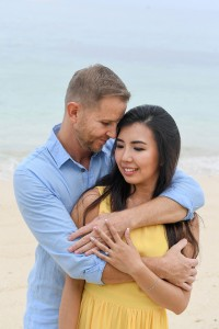 The newly engaged couple share an intimate moment on Mamanunca beach Fiji
