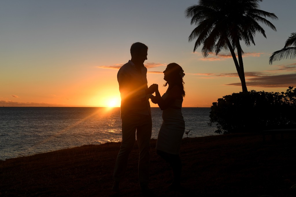 An intimate silhouette of the couple against the golden Fiji sunset