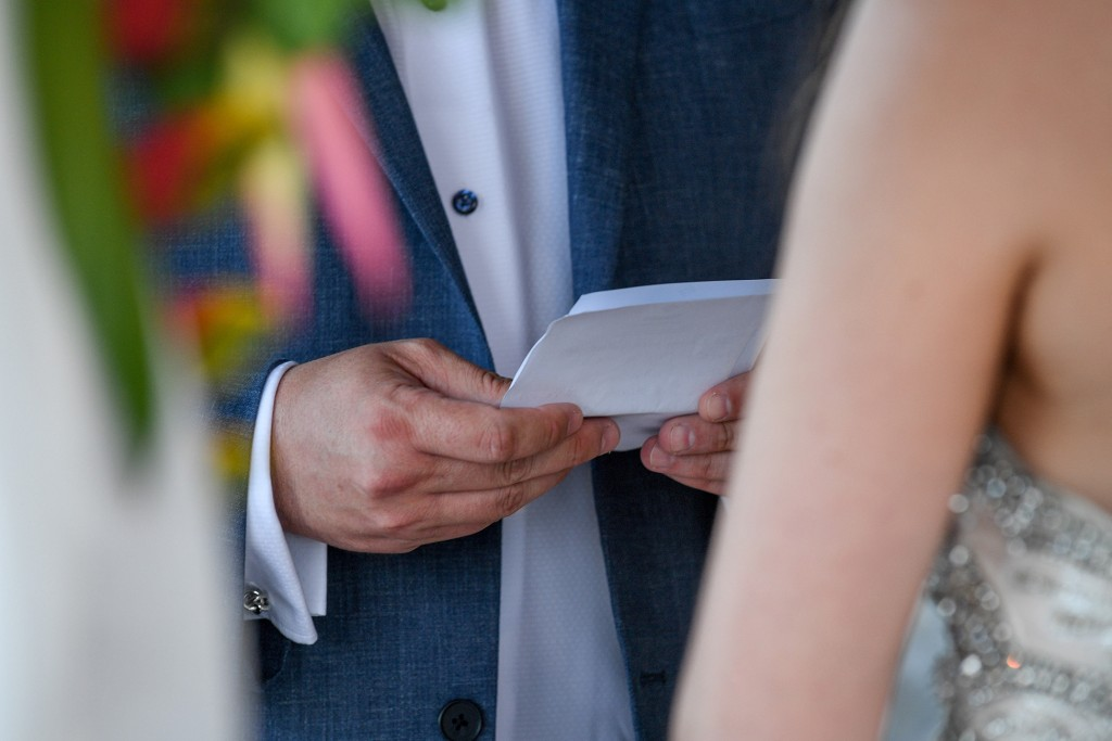 A closeup on the groom's vows