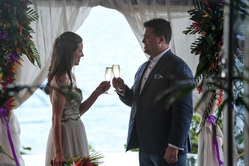 The newly weds toast at the altar to a happy marriage