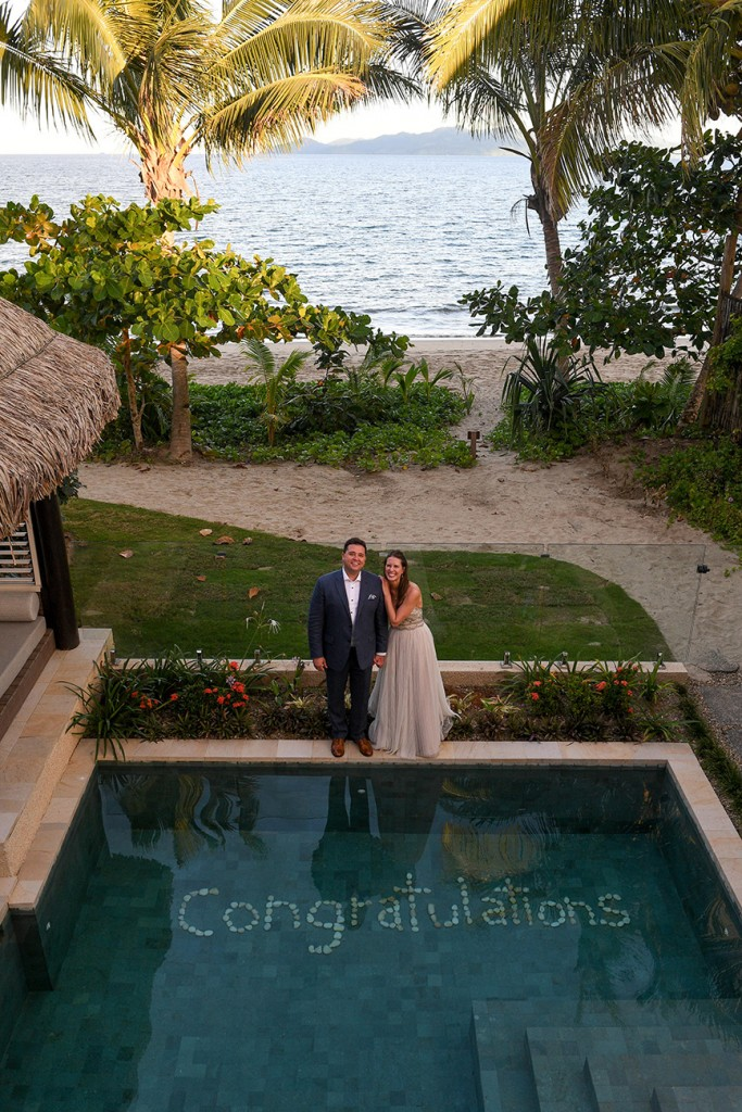 An aerial shot of Congratulations in the couple's private pool
