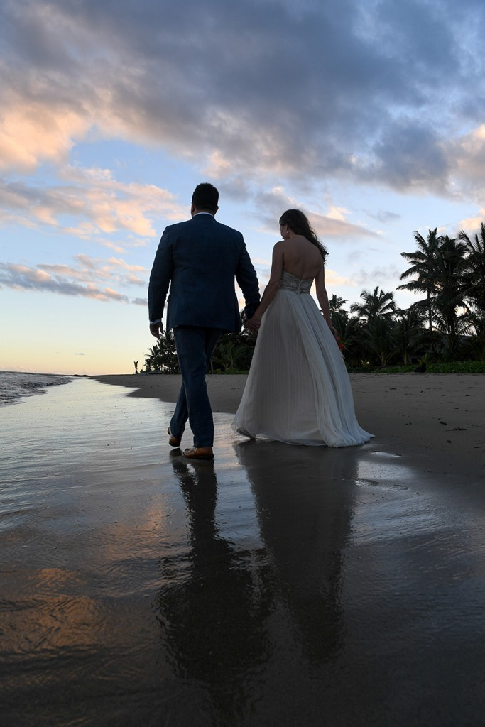 The newly weds stroll into the fading Fiji sunset
