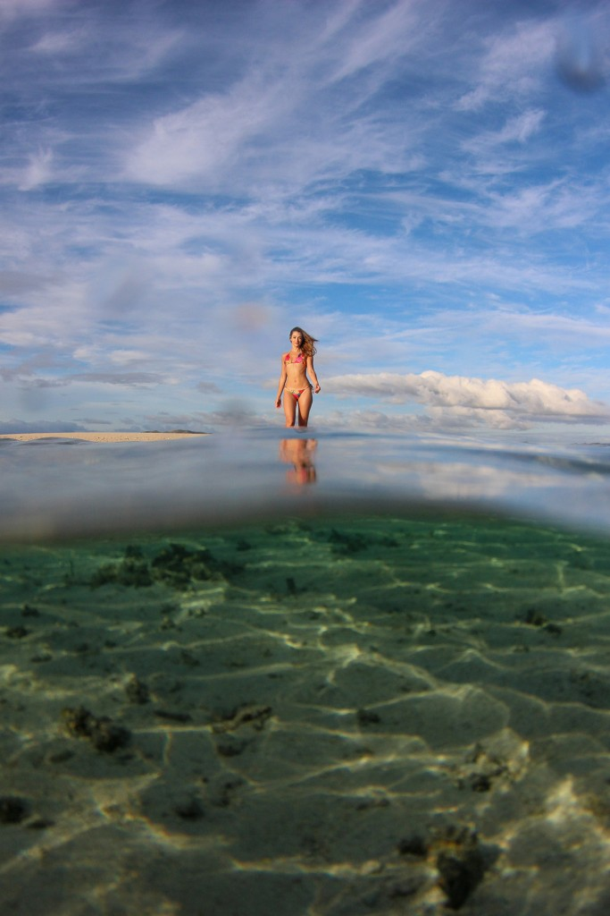 The bombshell blonde strolls in shallow waters of Fiji reef