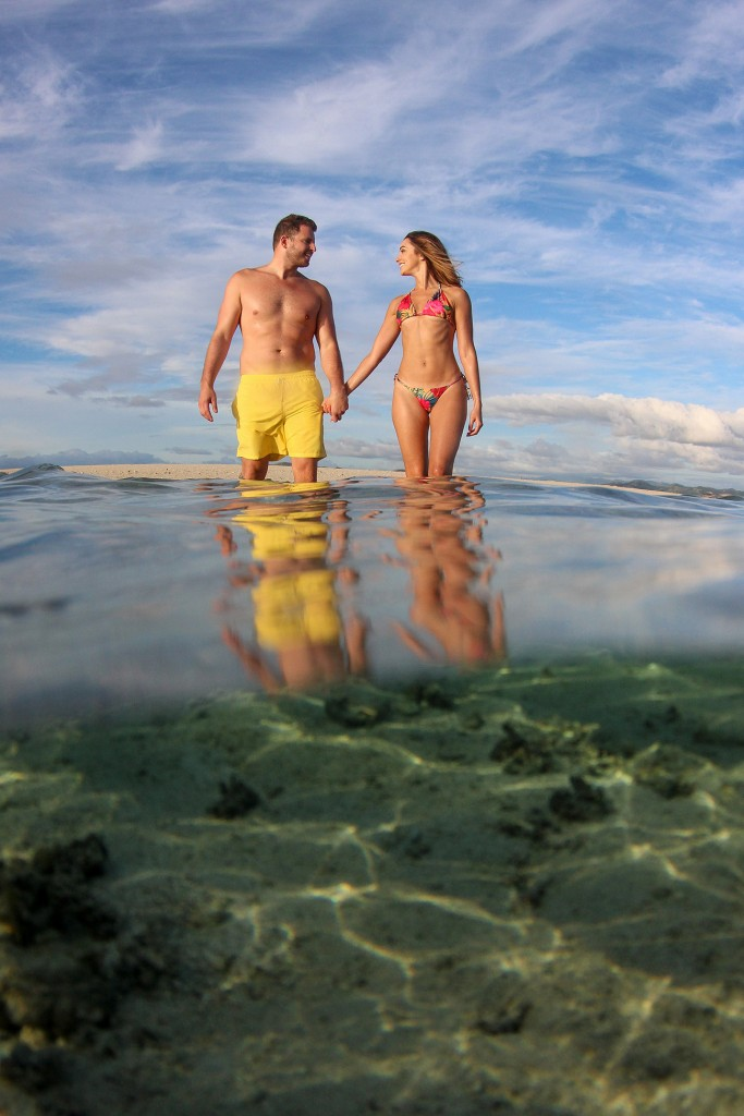 The fine couple hold hands in the shallow reefs of Nadi Fiji