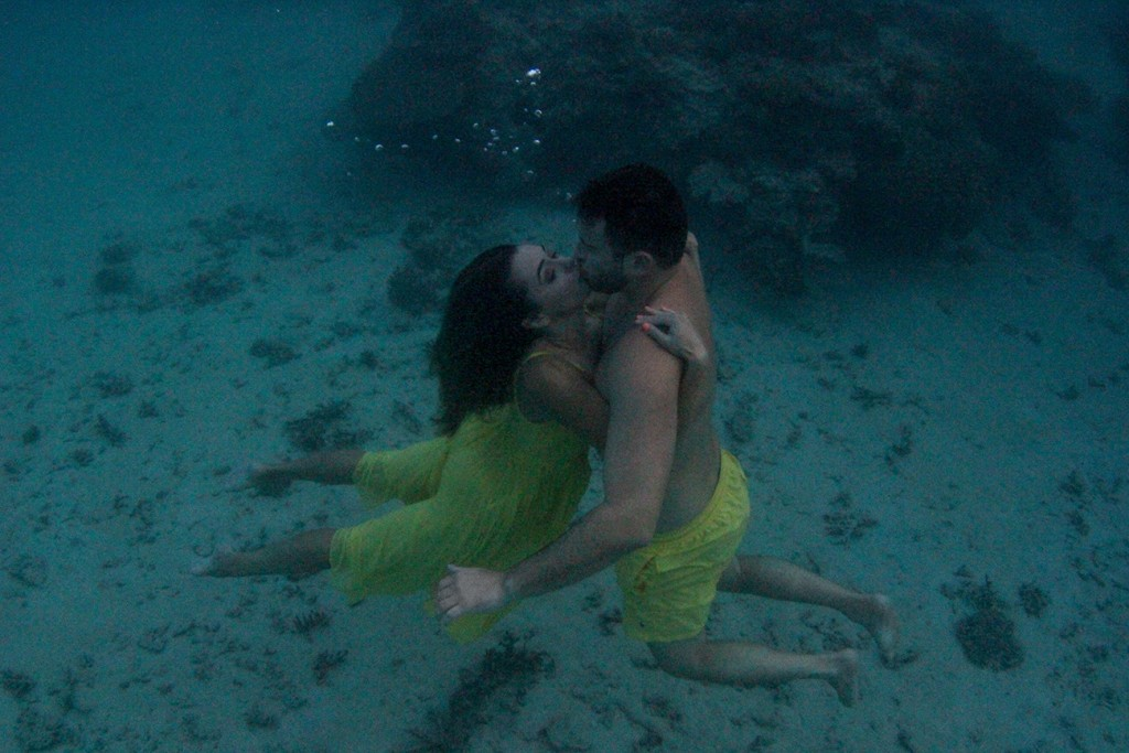 The couple passionately kisses at the floor of the reef at Nadi Fiji