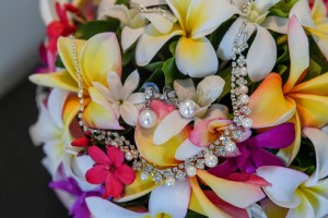 Small pearl earrings nested in a Tropical Fiji flower bouquet