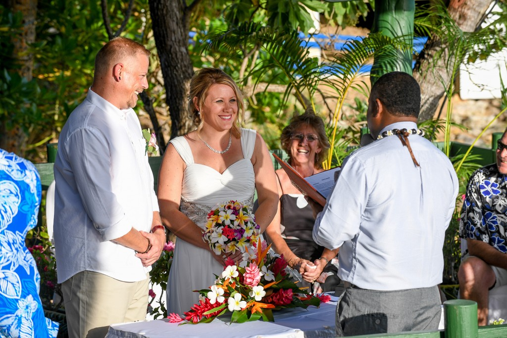 The bride smiles as the celebrant leads the vow ceremony