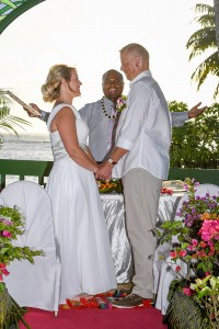 The celebrant happily pronounces the couple as man and wife against a stunning sunset