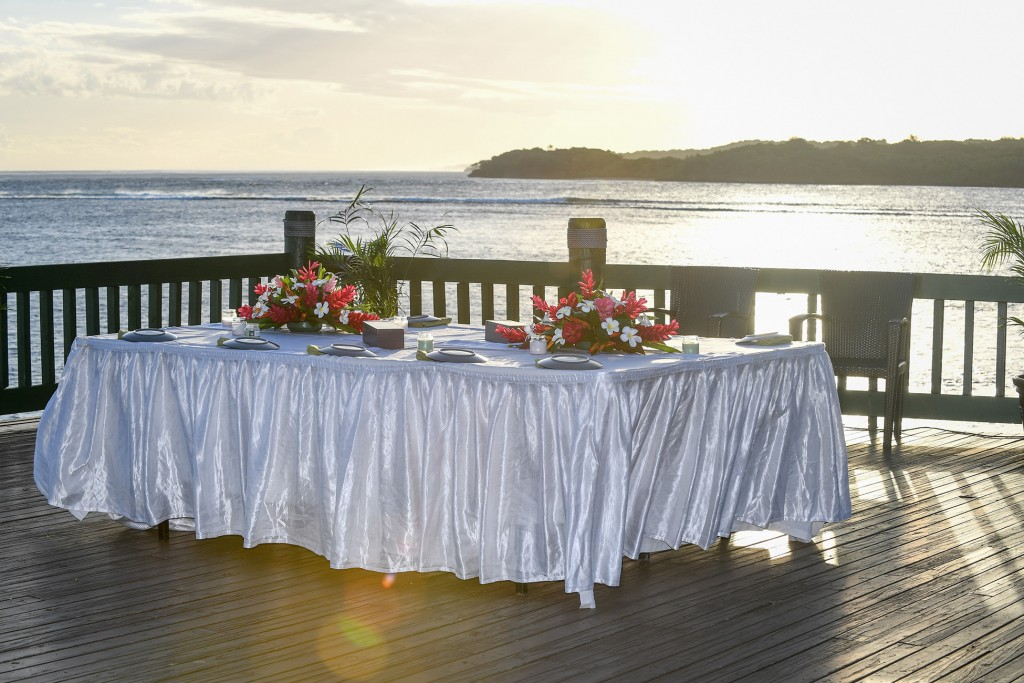 The exquisite wedding dinner set up on the dock overlooking the a