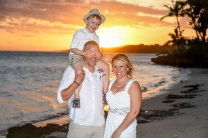 The new family goof around during a breathtaking Fiji sunset