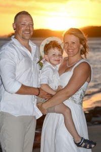 A picture perfect portrait of the family against the fiery Fiji sunset