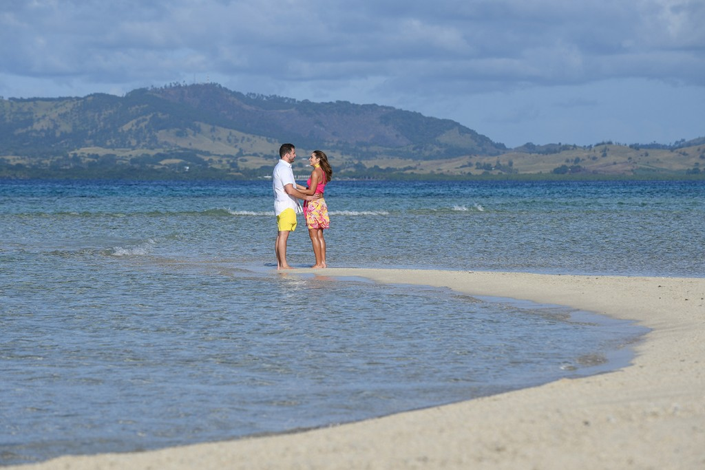 The couple hold hands at the shore of Nadi Fiji