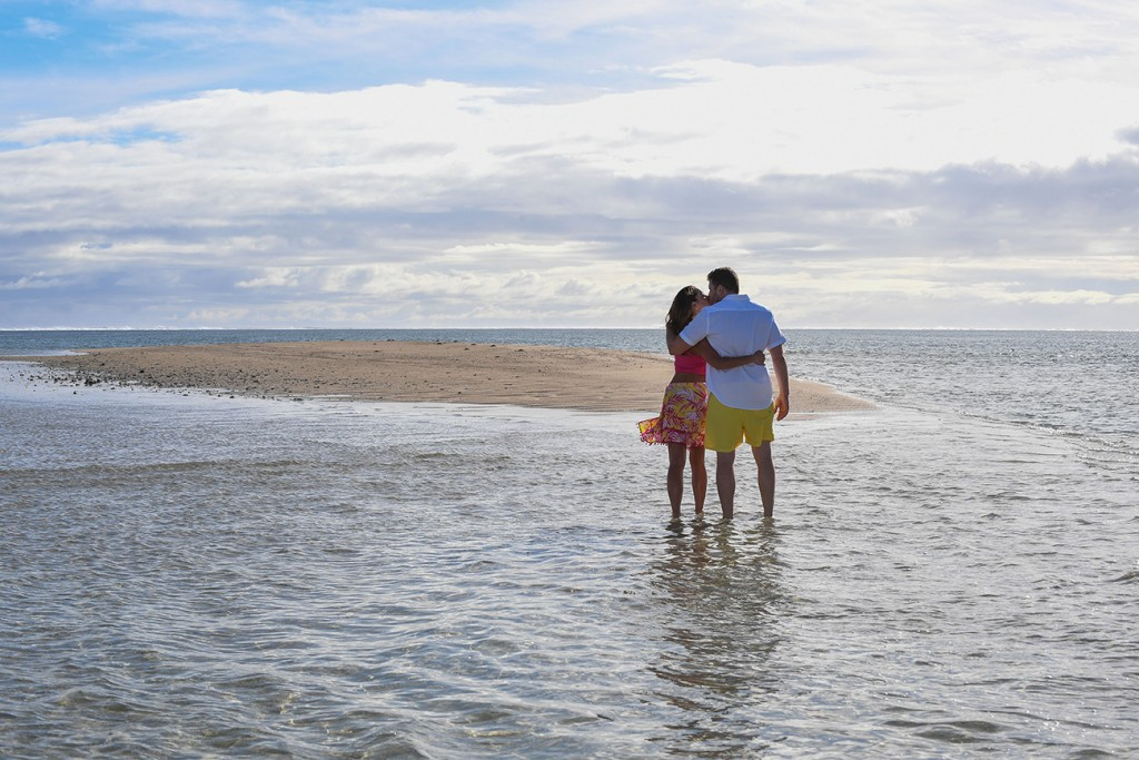 The couple embraces in the shallow waters of Nadi Fiji