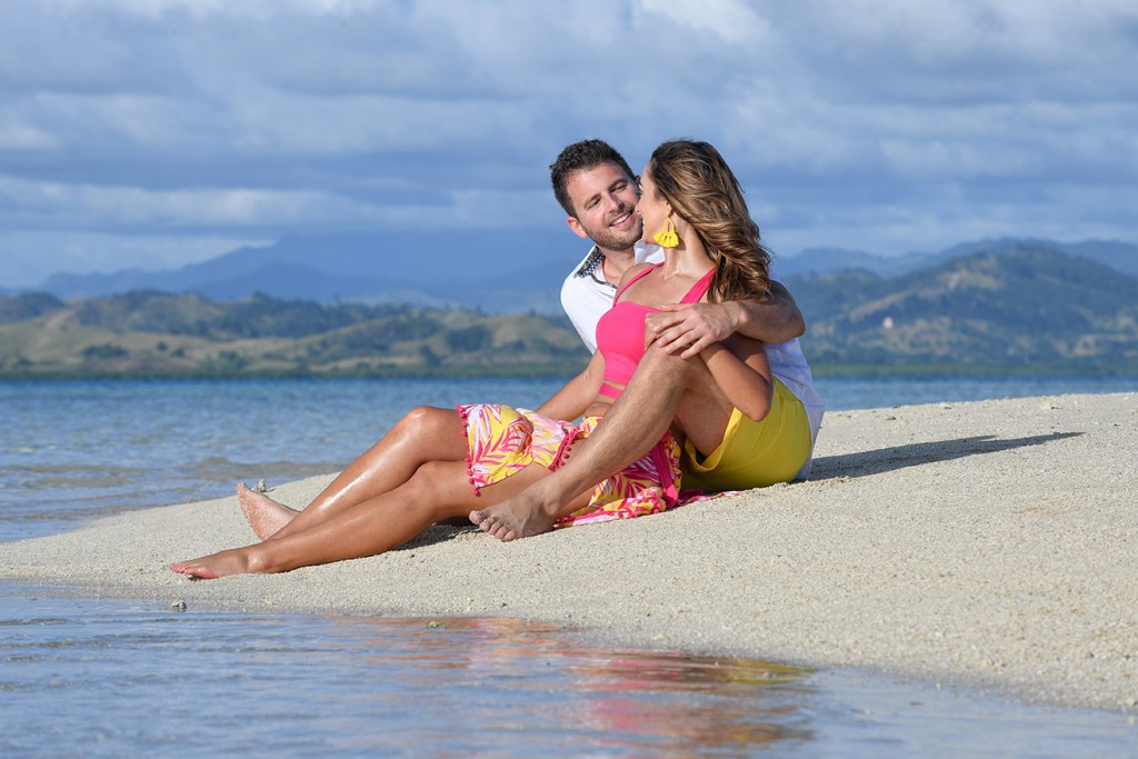 The couple enjoy the warm beige sands of Nadi Fiji